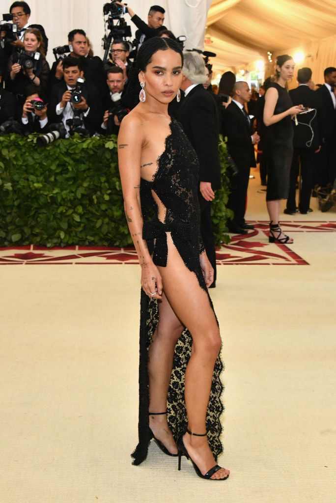 Zoë Kravitz Kravitz attended the 2018 Met Gala on May 7 in a Saint Laurent lace dress that exposed her whole right side. She looked amazing.