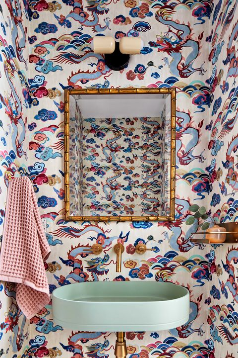 powder room with mint green hand basin, gold faucet and gold plumbing, golden mirror, light pink and blue chinese wallpaper, pink hand towel