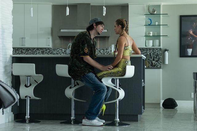 "nick braun left stars as ""derrek"" and riley keough right stars as ""stefani"" in director janicza bravo's zola, an a24 films release cr anna kooris  a24 films"