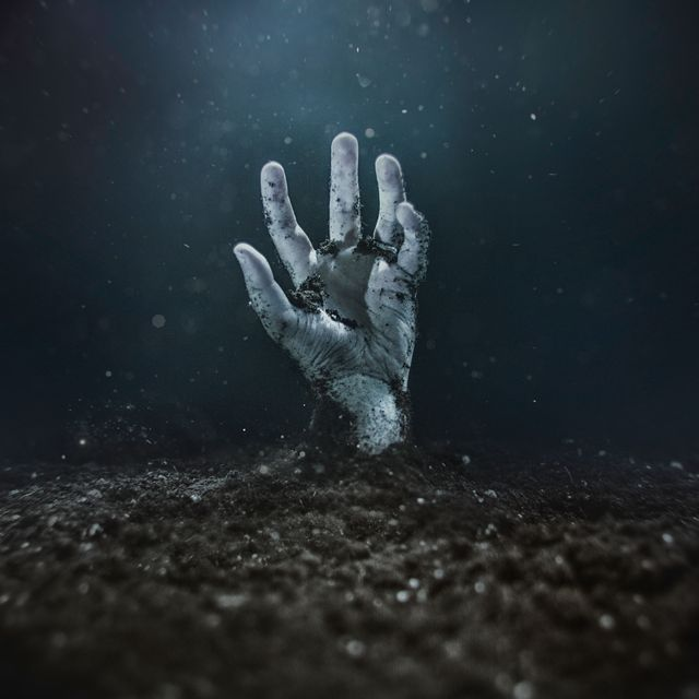 Zombie hand emerging from the ground