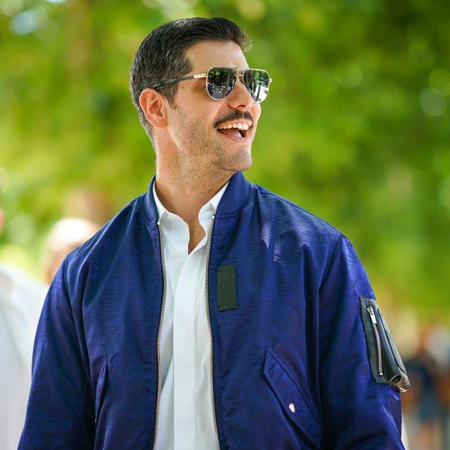 paris, france   june 21   kadu dantas wears mirrored sunglasses, a white shirt, a blue jacket , outside berluti, during paris fashion week   menswear springsummer 2020, on june 21, 2019 in paris, france photo by edward berthelotgetty images