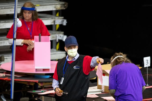 phoenix, az   may 01 contractors working for cyber ninjas, who was hired by the arizona state senate, examine and recount ballots from the 2020 general election at veterans memorial coliseum on may 1, 2021 in phoenix, arizona the maricopa county ballot recount comes after two election audits found no evidence of widespread fraud  photo by courtney pedrozagetty images