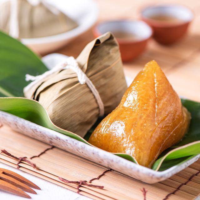 zongzi   alkaline chinese rice dumpling crystal food on a plate to eat for traditional dragon boat duanwu festival concept