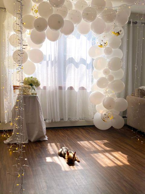 Decoration, White, Floor, Interior design, Room, Curtain, Flooring, Yellow, Lighting, Architecture,