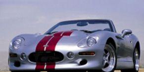 Mode of transport, Automotive design, Vehicle, Automotive lighting, Headlamp, Land vehicle, Car, Photograph, Red, Performance car,