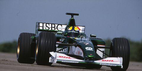 Tire, Wheel, Automotive tire, Automotive design, Open-wheel car, Green, Automotive exterior, Automotive wheel system, Formula one car, Formula one tyres,