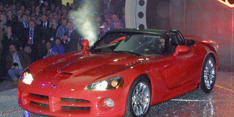 Tire, Wheel, Automotive design, Vehicle, Event, Land vehicle, Performance car, Hood, Red, Car,