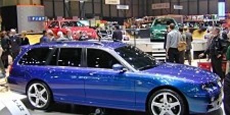 Tire, Motor vehicle, Wheel, Mode of transport, Blue, Transport, Vehicle, Automotive tire, Rim, Automotive design,