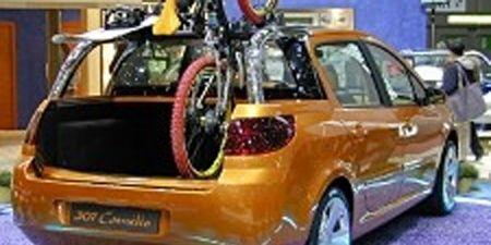Tire, Motor vehicle, Wheel, Mode of transport, Automotive design, Product, Vehicle, Yellow, Transport, Land vehicle,