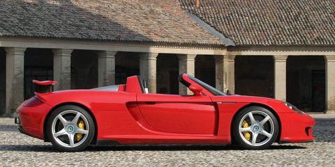 Tire, Wheel, Automotive design, Vehicle, Rim, Alloy wheel, Spoke, Supercar, Red, Performance car,