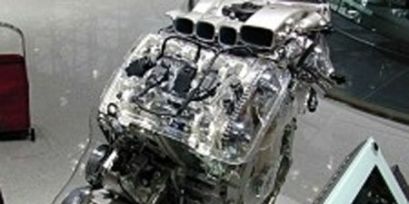 Motor vehicle, Mode of transport, Property, Photograph, White, Technology, Automotive exterior, Black, Machine, Grey,