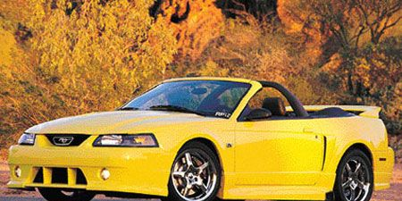 Tire, Wheel, Automotive design, Vehicle, Yellow, Transport, Hood, Infrastructure, Car, Automotive parking light,