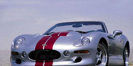 Mode of transport, Automotive design, Vehicle, Land vehicle, Automotive lighting, Car, Headlamp, Red, Sports car, Performance car,