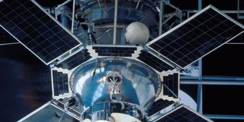 Space, Electric blue, Design, Engineering, Symmetry, Circle, Space station, Outer space, Satellite, Science,