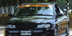 Motor vehicle, Mode of transport, Automotive design, Vehicle, Land vehicle, Car, Hood, Photograph, Vehicle registration plate, White,