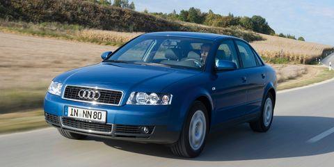 Motor vehicle, Tire, Road, Automotive design, Blue, Daytime, Automotive mirror, Transport, Vehicle, Hood,