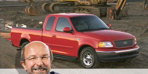 Motor vehicle, Wheel, Glasses, Vehicle, Land vehicle, Shirt, Truck, Automotive tire, Hood, Automotive parking light,