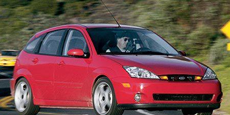 Tire, Motor vehicle, Wheel, Nature, Automotive design, Daytime, Transport, Vehicle, Yellow, Land vehicle,