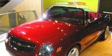 Motor vehicle, Mode of transport, Automotive design, Vehicle, Automotive mirror, Land vehicle, Hood, Grille, Red, Car,