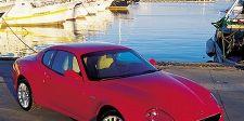 Motor vehicle, Mode of transport, Nature, Automotive design, Transport, Rim, Alloy wheel, Car, Red, Photograph,