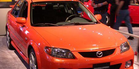 Motor vehicle, Vehicle, Automotive design, Automotive mirror, Car, Hood, Red, Fender, Vehicle door, Automotive parking light,