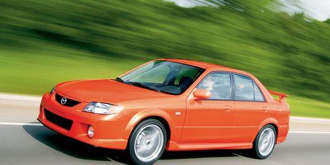 Tire, Wheel, Automotive design, Automotive mirror, Vehicle, Automotive parking light, Automotive lighting, Rim, Car, Hood,