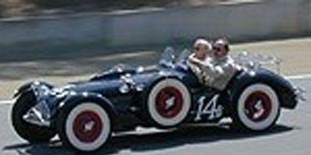Mode of transport, Automotive design, Land vehicle, Photograph, Car, White, Asphalt, Automotive tire, Fender, Automotive wheel system,
