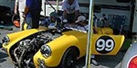 Motor vehicle, Wheel, Mode of transport, Automotive design, Yellow, Transport, Photograph, Hood, Headlamp, Automotive wheel system,