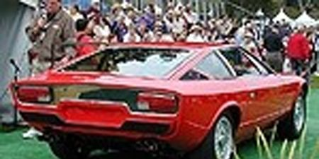 Tire, Automotive design, Mode of transport, People, Vehicle, Transport, Red, Photograph, Car, Fender,