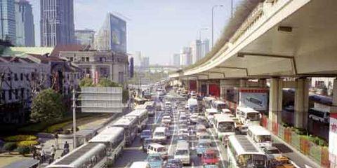 Motor vehicle, Mode of transport, Transport, Architecture, Neighbourhood, Property, Urban area, Metropolitan area, City, Automotive exterior,