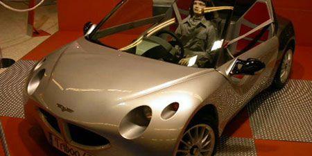 Motor vehicle, Mode of transport, Automotive design, Vehicle, Automotive mirror, Car, Vehicle door, Performance car, Alloy wheel, Fender,