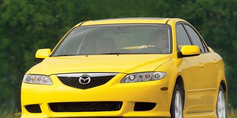 Tire, Motor vehicle, Mode of transport, Automotive design, Daytime, Vehicle, Yellow, Land vehicle, Headlamp, Hood,