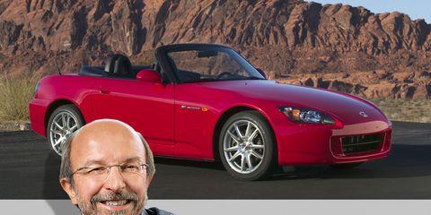 Tire, Wheel, Automotive design, Glasses, Vehicle, Land vehicle, Hood, Car, Shirt, Red,