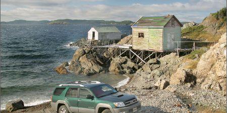 Tire, Wheel, Automotive tire, Coastal and oceanic landforms, Car, Coast, Automotive exterior, Fender, House, Rim,