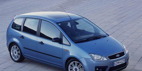 Tire, Motor vehicle, Wheel, Automotive mirror, Mode of transport, Automotive design, Blue, Daytime, Vehicle, Glass,