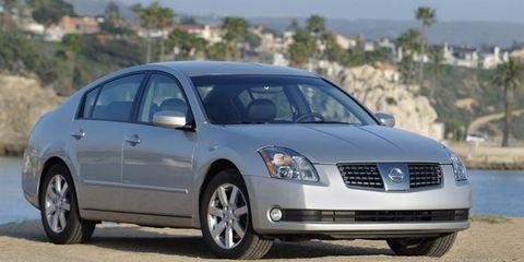 Tire, Motor vehicle, Wheel, Mode of transport, Automotive mirror, Blue, Daytime, Transport, Vehicle, Glass,