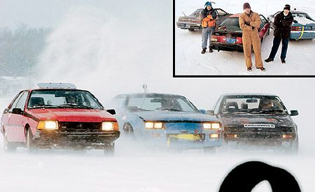 cars and testers in snow