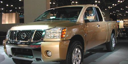 Tire, Wheel, Motor vehicle, Automotive tire, Mode of transport, Vehicle, Automotive mirror, Land vehicle, Automotive exterior, Natural environment,