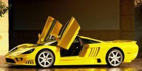 Motor vehicle, Mode of transport, Automotive design, Yellow, Transport, Rim, Supercar, Automotive wheel system, Automotive exterior, Alloy wheel,