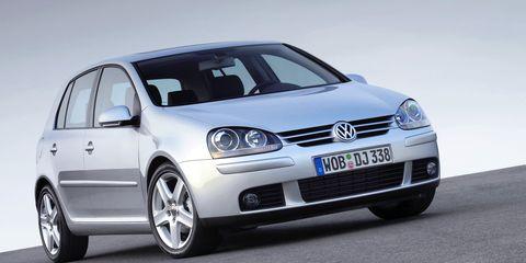 Automotive design, Daytime, Vehicle, Car, Rim, Alloy wheel, Headlamp, Automotive mirror, Automotive wheel system, Hood,