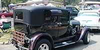 Motor vehicle, Mode of transport, Automotive design, Transport, Vehicle, Land vehicle, Property, Photograph, White, Fender,