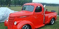 Motor vehicle, Automotive design, Vehicle, Transport, Red, Vehicle door, Automotive tire, Fender, Hood, Pickup truck,
