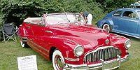 Mode of transport, Vehicle, Automotive design, Transport, Car, Red, Photograph, Fender, Automotive tire, Hood,