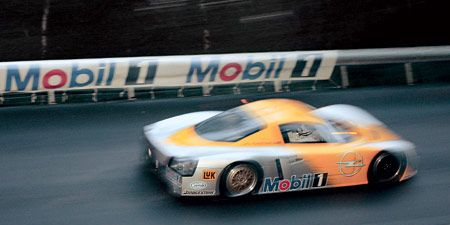 Mode of transport, Automotive design, Motorsport, Asphalt, Race track, Logo, Race car, Sports car, Racing, Auto racing,