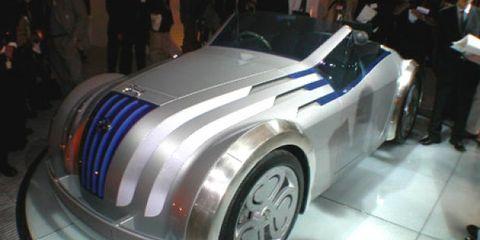 Wheel, Tire, Automotive design, Vehicle, Land vehicle, Event, Automotive wheel system, Car, Auto show, Automotive lighting,