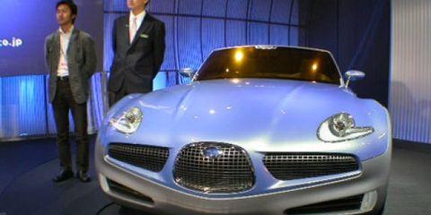 Automotive design, Vehicle, Event, Land vehicle, Grille, Headlamp, Car, Hood, Automotive exterior, Personal luxury car,