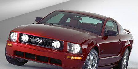 Automotive design, Vehicle, Automotive lighting, Hood, Headlamp, Land vehicle, Automotive exterior, Car, Automotive tire, Red,