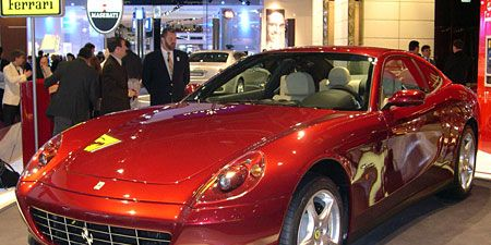 Tire, Wheel, Mode of transport, Automotive design, Vehicle, Land vehicle, Car, Rim, Red, Personal luxury car,