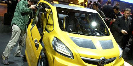Motor vehicle, Automotive design, Yellow, Vehicle, Vehicle registration plate, Car, Headlamp, Bumper, Hatchback, Hood,