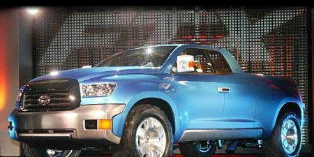 Tire, Wheel, Motor vehicle, Automotive design, Automotive tire, Blue, Automotive mirror, Vehicle, Land vehicle, Automotive lighting,
